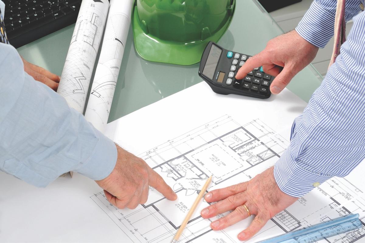 Renovation contractors reviewing blueprints