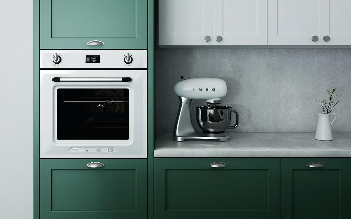 Forest green units and Smeg kitchen appliances in kitchen