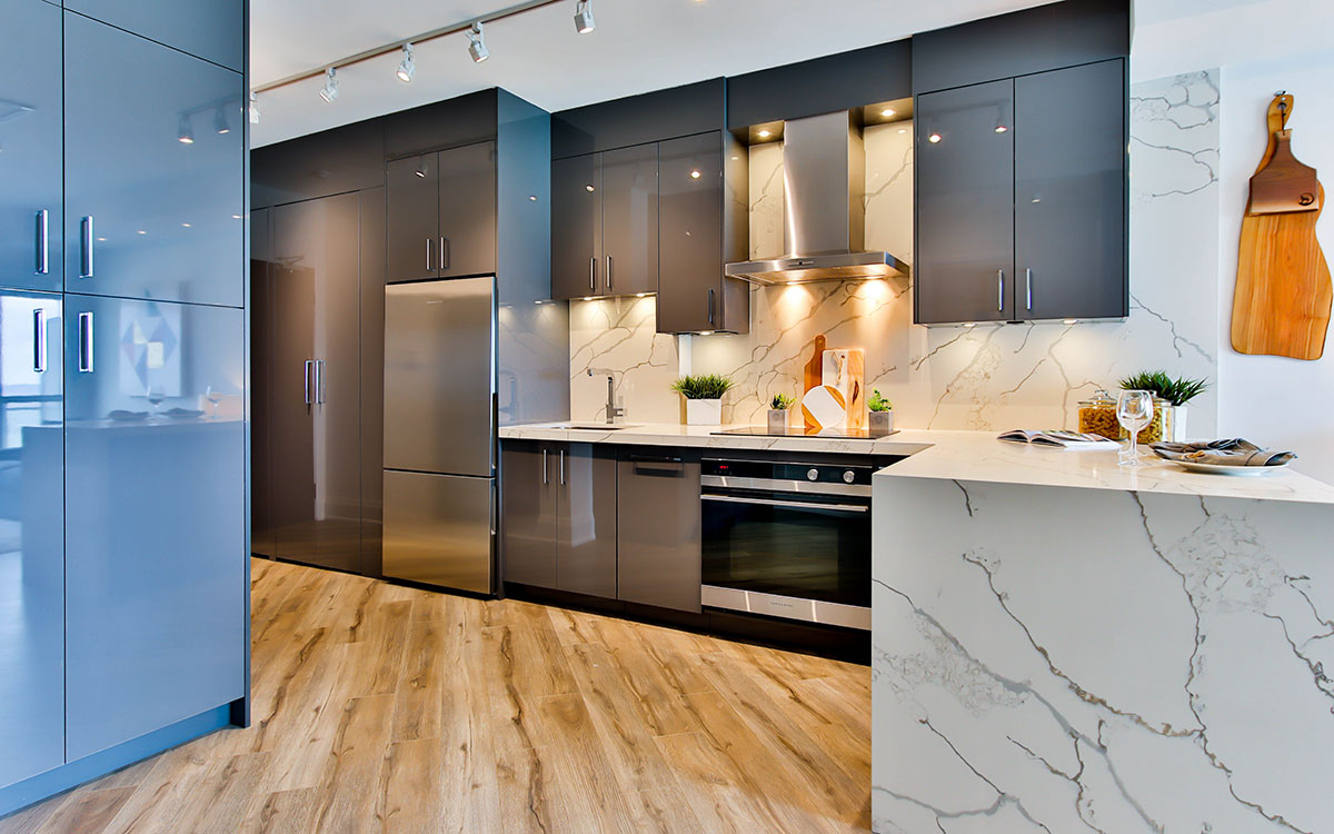Modern, curated kitchen with marble surfaces and hanging kitchen appliances
